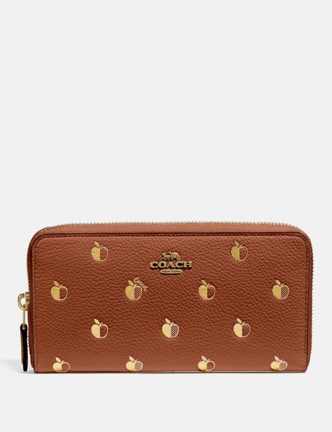 Accordion Zip Wallet With Apple Print is on sale for Black Friday at Coach, $150 (originally $250).