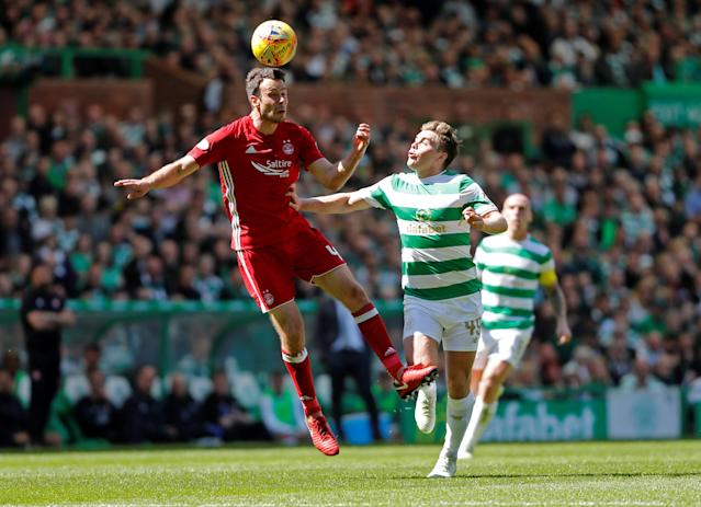 Soccer Football - Scottish Premiership - Celtic vs Aberdeen - Celtic Park, Glasgow, Britain - May 13, 2018 Aberdeen's Andrew Considine in action with Celtic's James Forrest REUTERS/Russell Cheyne