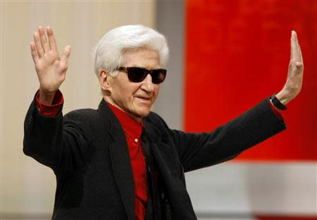 Director Alain Resnais reacts after receiving the Lifetime Achievement award during the award ceremony at the 62nd Cannes Film Festival in this May 24, 2009 file picture. REUTERSEric Gaillard/Files