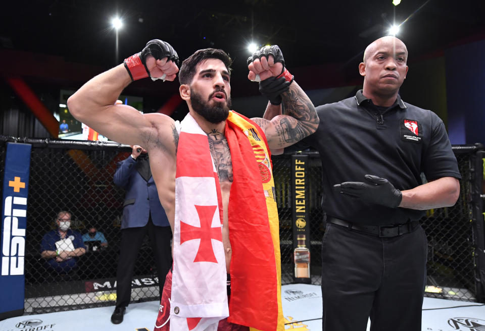 LAS VEGAS, NEVADA - DECEMBER 05: Ilia Topuria of Germany celebrates after his knockout victory over Damon Jackson in a featherweight bout during the UFC Fight Night event at UFC APEX on December 05, 2020 in Las Vegas, Nevada. (Photo by Chris Unger/Zuffa LLC)