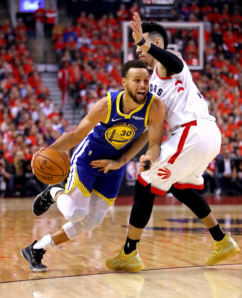 Stephen Curry #30 of the Golden State Warriors is defended by Danny Green #14 of the Toronto Raptors in the first half during Game Five of the 2019 NBA Finals at Scotiabank Arena on June 10, 2019 in Toronto, Canada. (Photo by Gregory Shamus/Getty Images)