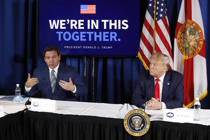 Gov. Ron DeSantis speaks alongside President Donald Trump during a roundtable discussion on the coronavirus outbreak and storm preparedness, with Hurricane Isaias looming, at Pelican Golf Club in Belleair, Fla., on July 31.