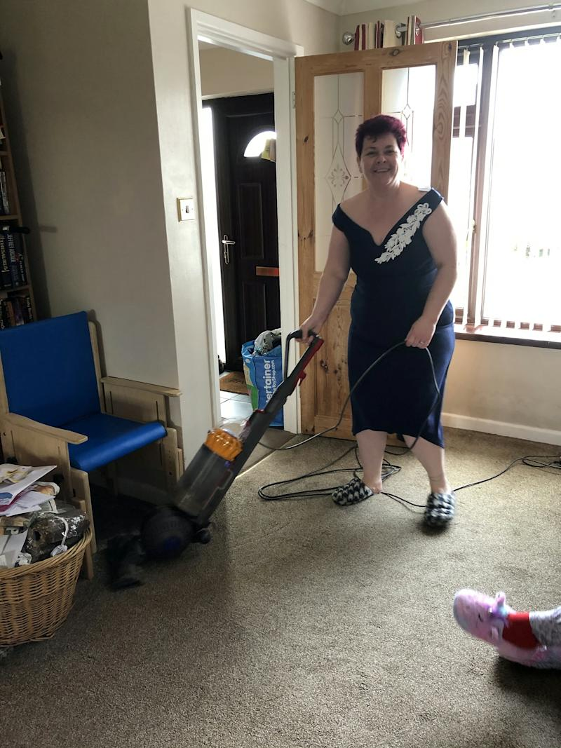 Hoovering in normal clothes is so overrated. (SWNS)