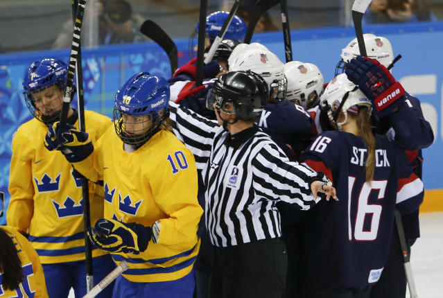 Emilia Anderson of Sweden and Johanna Olofsson of Sweden react after a goal by team USA during the first period of the 2014 Winter Olympics women's semifinal ice hockey game at Shayba Arena Monday, Feb. 17, 2014, in Sochi, Russia. (AP Photo/Julio Cortez)