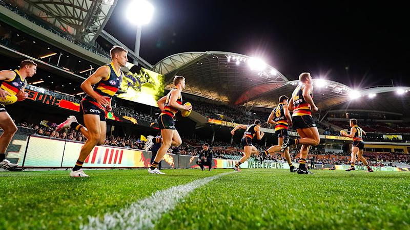 Adelaide Crows players, pictured here running onto the ground for their clash with St Kilda.