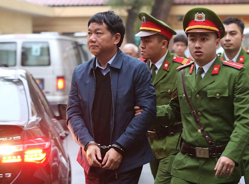 Former politbureau member Dinh La Thang is also on trial over mismanagement at PetroVietnam Construction and could face 20 years in jail (AFP Photo/-)