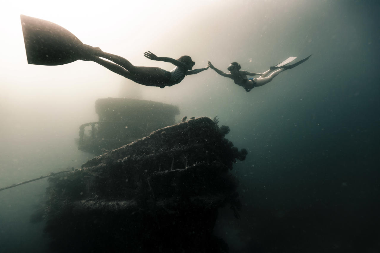 <p>Two free divers swim near to a shipwreck in the Caribbean. (Photo: Alex Voyer/Caters News) </p>