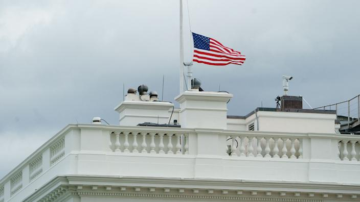 The flag above the White House flies at half staff in honor of the Indianapolis, Indiana shooting victims, in Washington, DC on April 16, 2021. (Mandel Ngan/AFP via Getty Images)