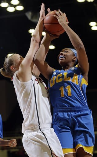 UCLA 's Atonye Nyingifa (11) shoots next to Stanford 's Mikaela Ruef during the second half of an NCAA college basketball game in Stanford, Calif., Friday, Jan. 18, 2013. (AP Photo/Marcio Jose Sanchez)