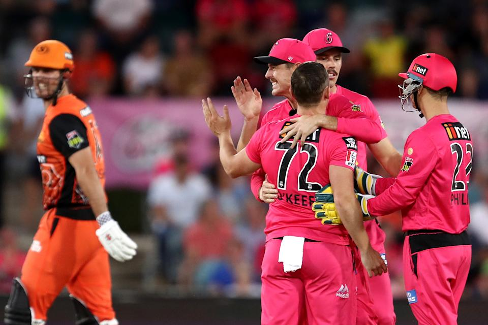 Stephen O'Keefe celebrates with team mates after claiming the wicket of Mitch Marsh during the Big Bash League match between the Sydney Sixers and the Perth Scorchers at Manuka Oval.