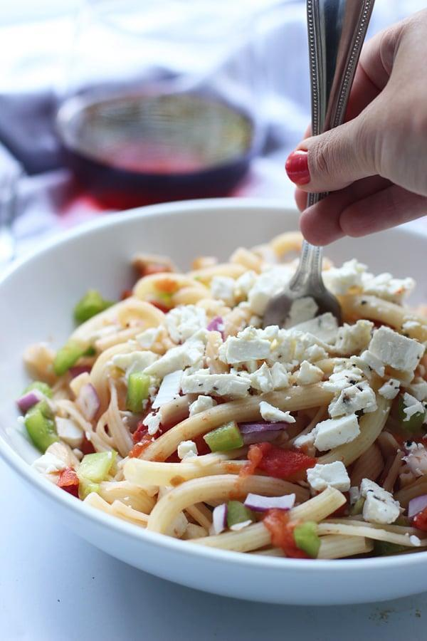 """<p>Whisk your taste buds away to the islands of Greece when you make this divine dish. You'll need ripe tomatoes, garlic, dry rosé or white wine, green peppers, red onions, pasta, and feta cheese. Add a dash of olive oil, and you'll be drooling before the noodles are even done cooking.</p> <p><strong>Get the recipe:</strong> <a href=""""http://www.cookingforkeeps.com/2014/06/10/greek-pasta-with-tomatoes-wine-and-feta/"""" class=""""link rapid-noclick-resp"""" rel=""""nofollow noopener"""" target=""""_blank"""" data-ylk=""""slk:Greek pasta with tomatoes, wine, and feta"""">Greek pasta with tomatoes, wine, and feta</a></p>"""