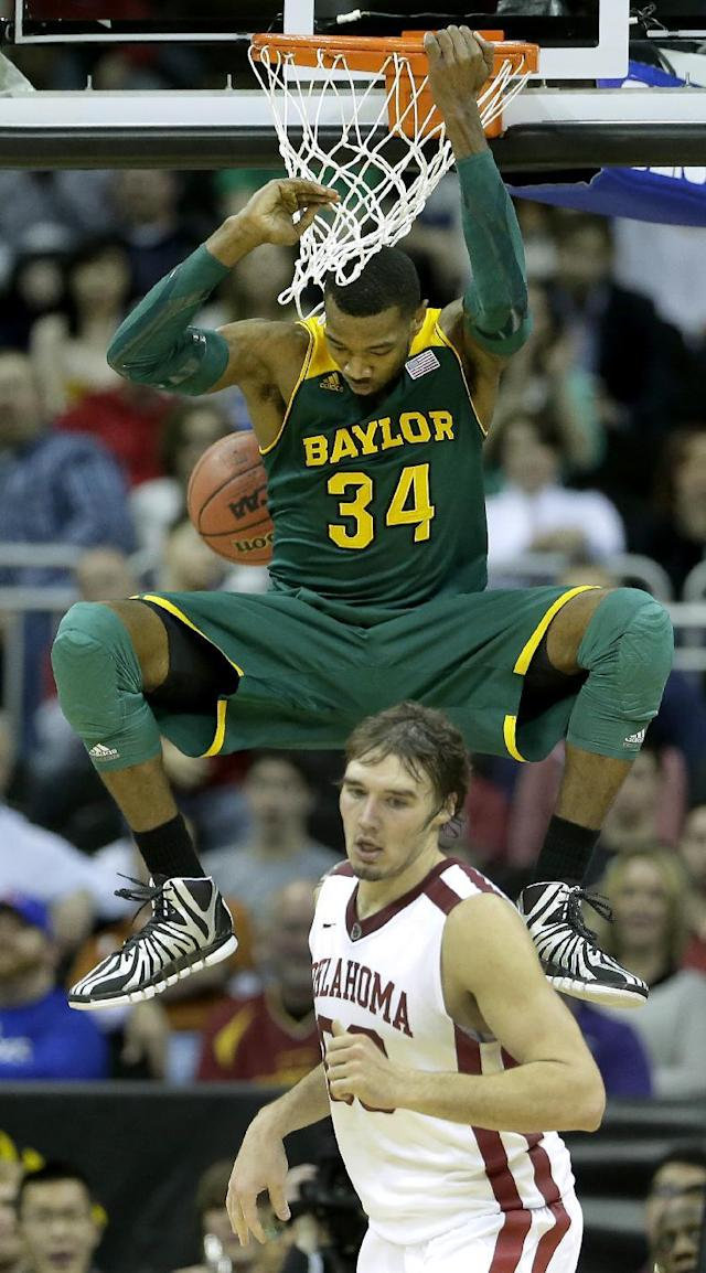 Baylor's Cory Jefferson (34) gets past Oklahoma's Ryan Spangler to dunk the ball during the first half of an NCAA college basketball game in the Big 12 men's tournament on Thursday, March 13, 2014, in Kansas City, Mo. (AP Photo/Charlie Riedel)