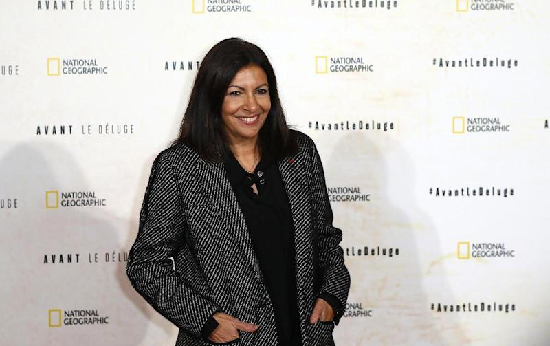 FILE - In this file photo dated Monday Oct. 17, 2016, Paris Mayor Anne Hidalgo poses for photographers during a photo call for the french premiere of the film 'Before the Flood', ('Avant Le Deluge') at Chatelet Theater in Paris. Hidalgo has pushed back at U.S. President Donald Trump for insulting Paris, saying American tourist reservations are up 30 percent in 2017 so far compared to last year. (AP Photo/Francois Mori, FILE)
