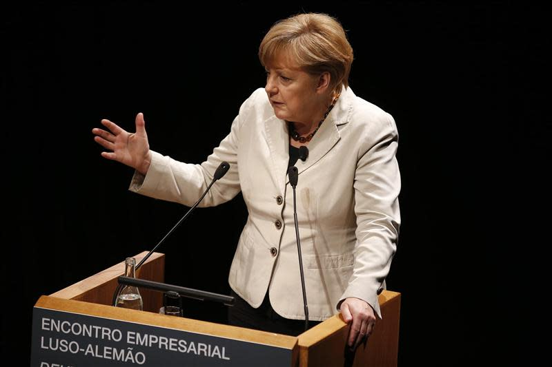 German Chancellor Angela Merkel gives a speech during a meeting with Portuguese-German businessmen in Lisbon