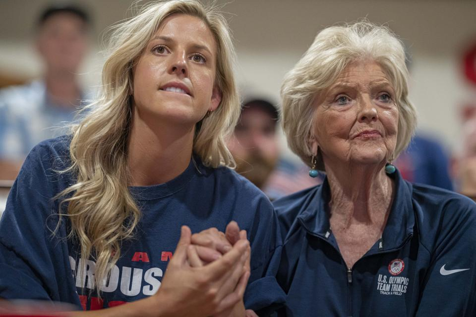 Cousin Haley Crouser, left, and grandmother Marie Crouser, right, watch with friends and family in Redmond, Ore., Wednesday, Aug. 4, 2021, as Ryan Crouser competes in the men's shot put finals at the Tokyo Olympics. (AP Photo/Nathan Howard)