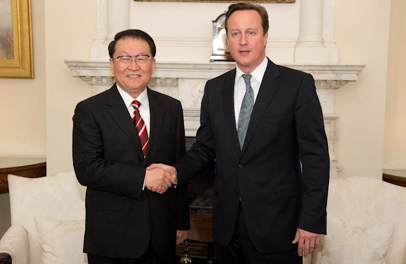 Chinese Communist Party official Li Changchun, left, shakes hands with British Prime Minister David Cameron during their meeting at Downing Street in central London on Tuesday April 17, 2012. (AP Photo/Leon Neal. Pool)