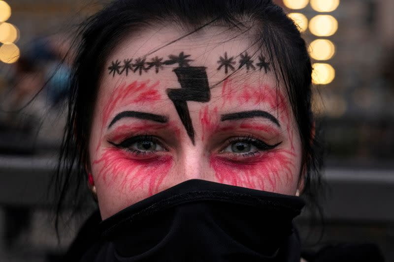 FILE PHOTO: A woman takes part in a protest against the ruling by Poland's Constitutional Tribunal that imposes a near-total ban on abortion, in Gdansk