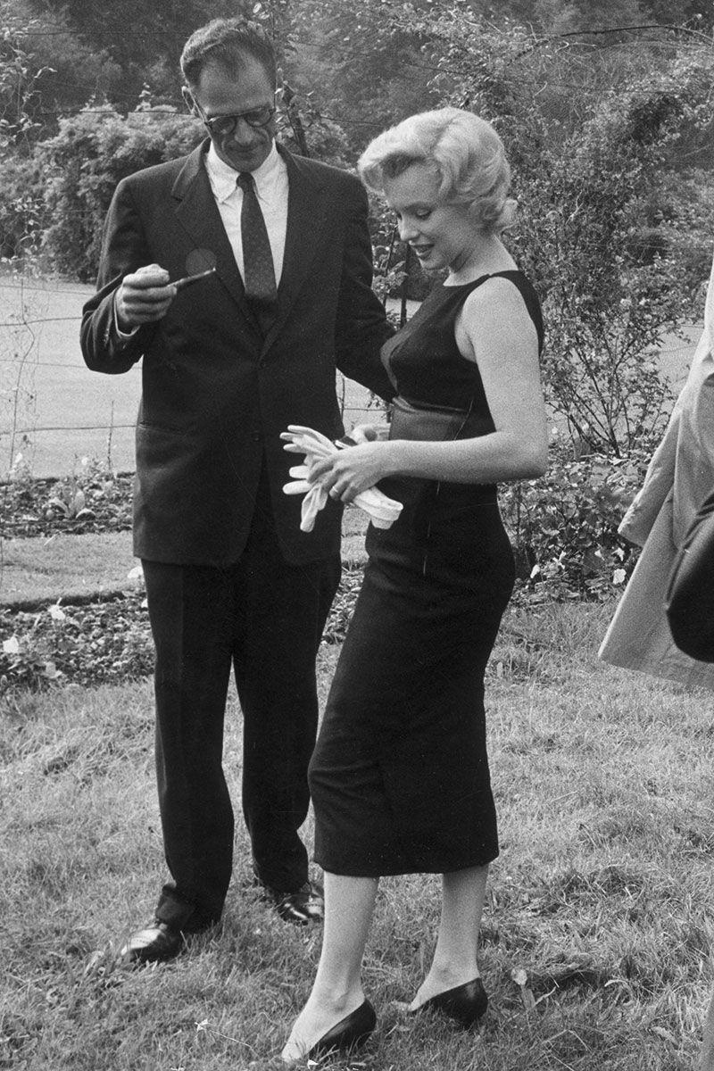 <p>Marilyn Monroe's chic figure-hugging black sheath dress is proof that less is more. </p>