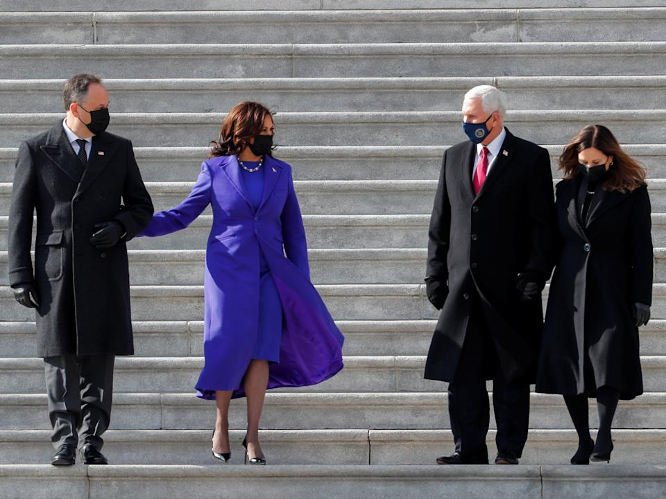 Former Vice President Mike Pence, his wife Karen Pence, the new Vice President Kamala Harris, and her husband Doug Emhoff walk down the stairs after the inauguration. Mr Pence attended the ceremony but not Donald Trump who left Washington before the ceremony beganREUTERS