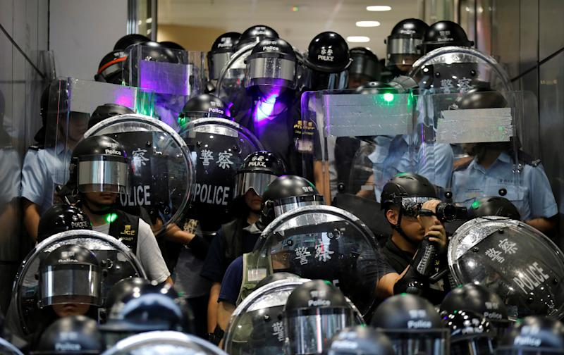 "Riot police stand guard outside Mong Kok police station during the ""Reclaim Hung Hom and To Kwa Wan, Restore Tranquility to Our Homeland"" demonstration against the extradition bill, Hong Kong, China August 17, 2019. REUTERS/Kim Hong-Ji"