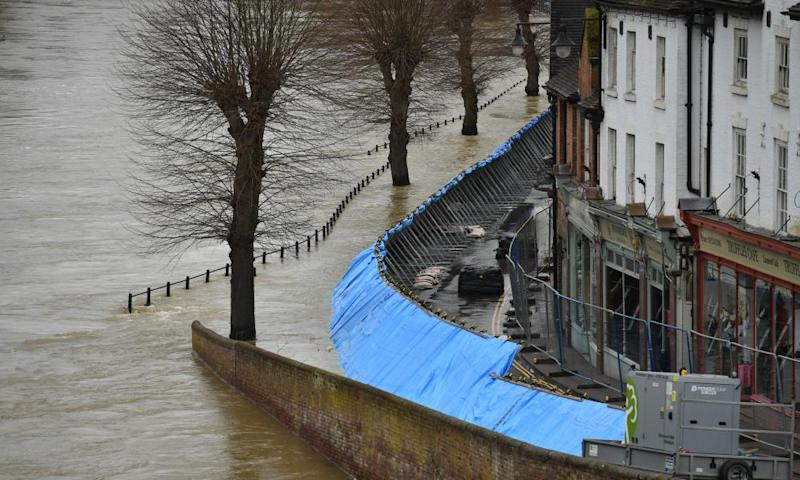 Temporary flood barriers hold back the River Severn in Ironbridge, Shropshire.