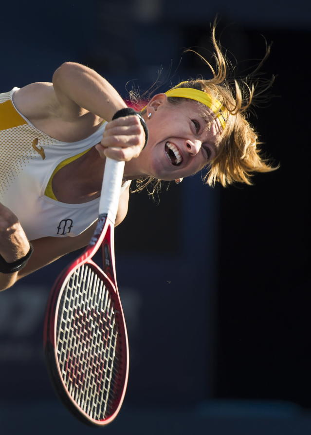 Marie Bouzkova, of the Czech Republic, serves against Serena Williams, of the United States, during semifinal Rogers Cup tennis tournament action in Toronto, Saturday, Aug. 10, 2019. (Nathan Denette/The Canadian Press via AP)