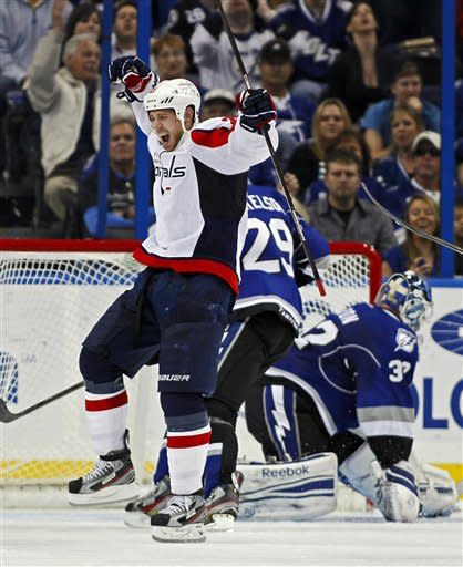 Washington Capitals' Brooks Laich celebrates his goal in front of Tampa Bay Lightning's Brendan Mikkelson (29) and goalie Mathieu Garon during the second period of an NHL hockey game, Saturday, Feb. 18, 2012, in Tampa, Fla. (AP Photo/Mike Carlson)