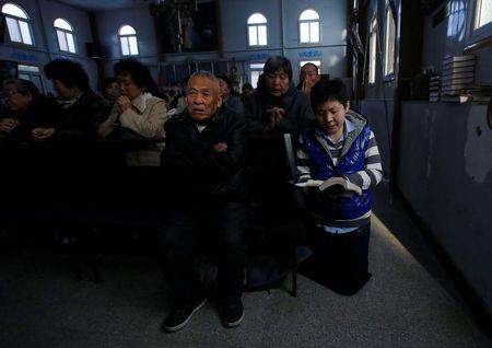 FILE PHOTO: Believers take part in a weekend mass at an underground Catholic church in Tianjin November 10, 2013. REUTERS/Kim Kyung-Hoon  File Photo