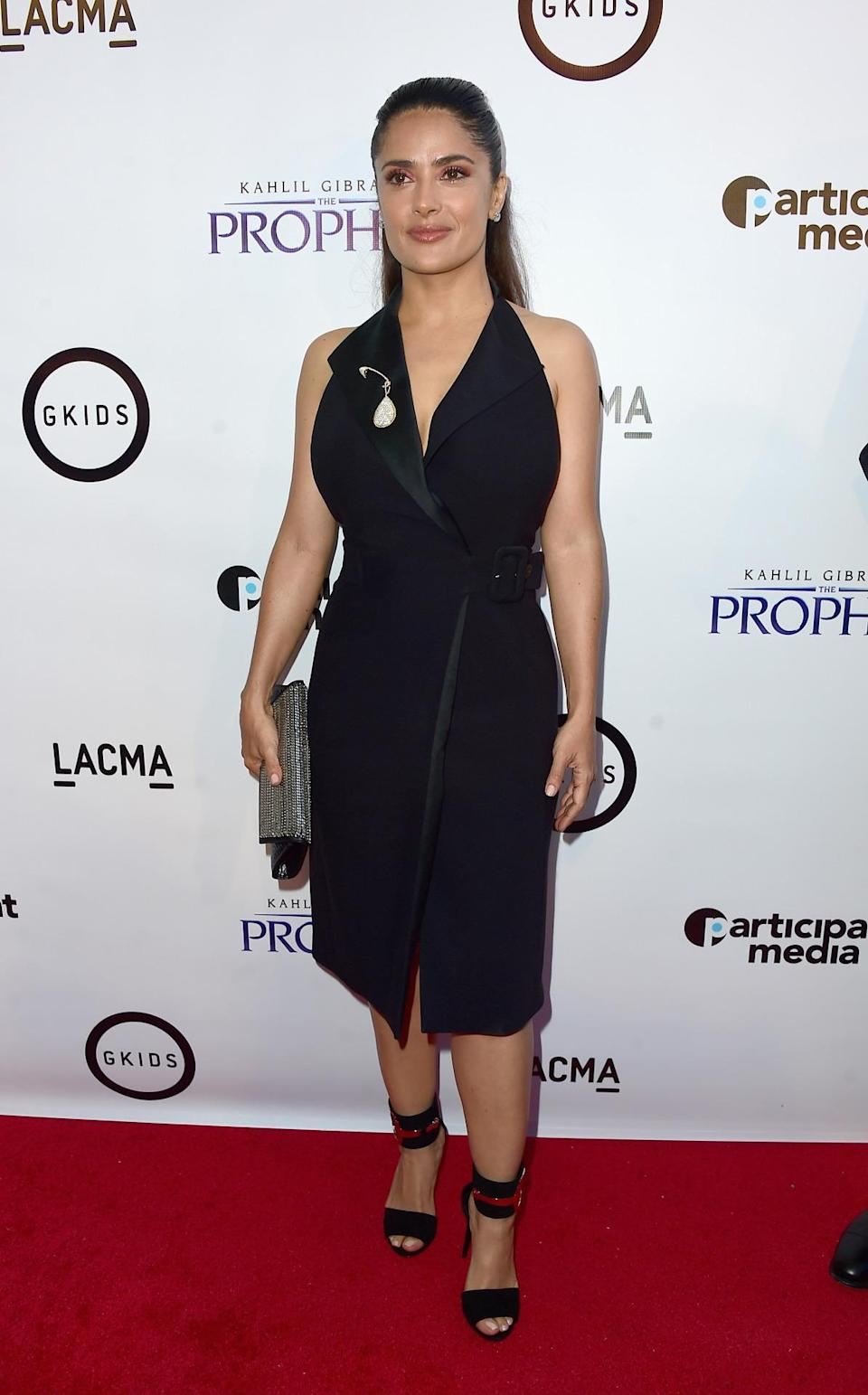 <p>The actress attended the premiere of <i>Khalil Gibran's The Prophet</i> with her 7-year-old daughter, Valentina Paloma, in a classic wrapped tuxedo dress from the Parisian fashion house.<br><br></p>