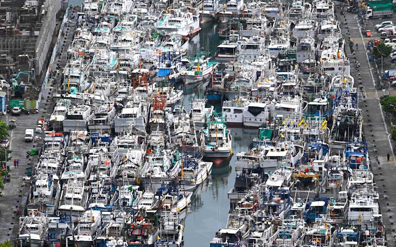 This overview shows fishing boats packed into the typhoon shelter at Nanfangao harbour in Suao, Yilan county, as Typhoon Lekima approaches off the shores of eastern Taiwan on August 8, 2019. | SAM YEH/Getty Images