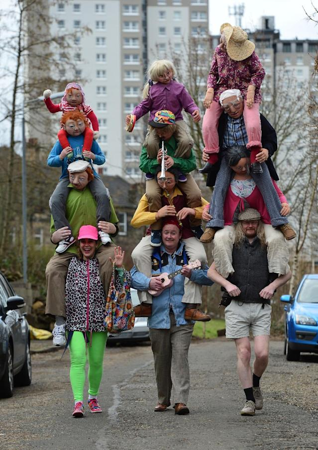 GLASGOW, SCOTLAND - MARCH 13 : Fans in fancy dress on there way to the Stadium ahead of the Scottish League Cup Final between Hibernian FC and Ross County FC at Hampden Park on March 13, 2016 in Glasgow, Scotland. (Photo by Mark Runnacles/Getty Images)