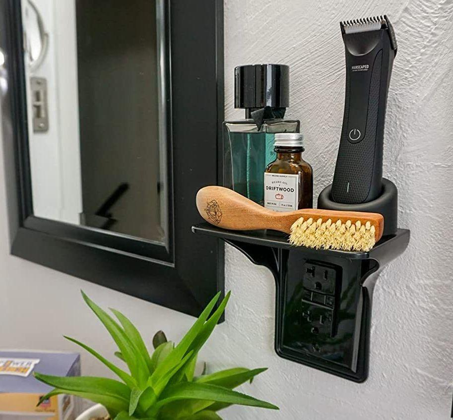 """Free up counter space on your bathroom vanity with this shelf, and<i>finally</i>give your electric toothbrush a home of its own.<br /><br /><strong>Promising review:</strong>""""I absolutely love this thing!<strong>I have much less clutter on my sink thanks to this.</strong>If there's anyone not sure if it will fit due to an object, all you need is 1.25 inches of space between the edge of your existing outlet plate and the piece of furniture. I have a GFCI with a standard wall plate."""" —<a href=""""https://www.amazon.com/dp/B01ED97QTG?tag=huffpost-bfsyndication-20&ascsubtag=5834502%2C13%2C46%2Cd%2C0%2C0%2C0%2C962%3A1%3B901%3A2%3B900%3A2%3B974%3A3%3B975%3A2%3B982%3A2%2C16267135%2C0"""" target=""""_blank"""" rel=""""noopener noreferrer"""">Amazon Customer</a><br /><br /><strong>Get it from Amazon for<a href=""""https://www.amazon.com/dp/B01ED97QTG?tag=huffpost-bfsyndication-20&ascsubtag=5834502%2C13%2C46%2Cd%2C0%2C0%2C0%2C962%3A1%3B901%3A2%3B900%3A2%3B974%3A3%3B975%3A2%3B982%3A2%2C16267135%2C0"""" target=""""_blank"""" rel=""""noopener noreferrer"""">$6.76+</a>(available in three colors).</strong>"""