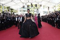 Kendall Jenner gave in to the crop top trend, arriving at the Palais des Festivals in a black ensemble by Azzedine Alaïa.