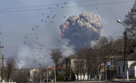 Flames shoot into sky from warehouse storing tank ammunition at military base in Balaklia