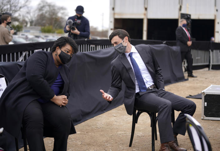 Stacey Abrams, left, and Jon Ossoff