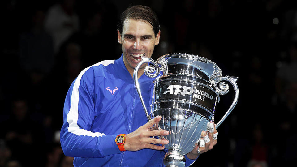 Rafael Nadal celebrating with the year-end World No.1 trophy in London.