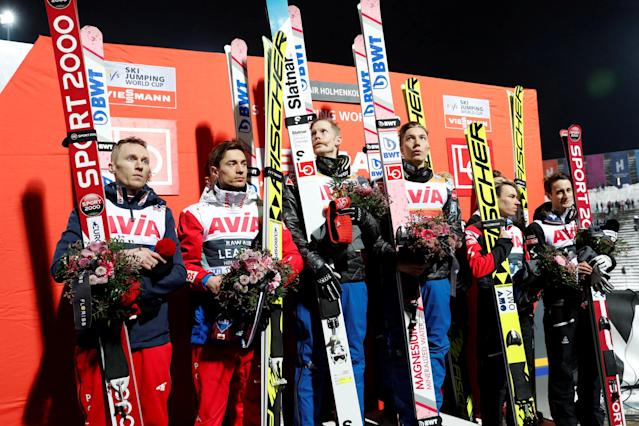 FIS Ski Jumping World Cup - Men's HS134 - Oslo, Norway - March 10, 2018. Members of second-placed Team Poland, first-placed Team Norway and third-placed Team Austria on the podium. NTB Scanpix/Terje Bendiksby via REUTERS ATTENTION EDITORS - THIS IMAGE WAS PROVIDED BY A THIRD PARTY. NORWAY OUT. NO COMMERCIAL OR EDITORIAL SALES IN NORWAY.