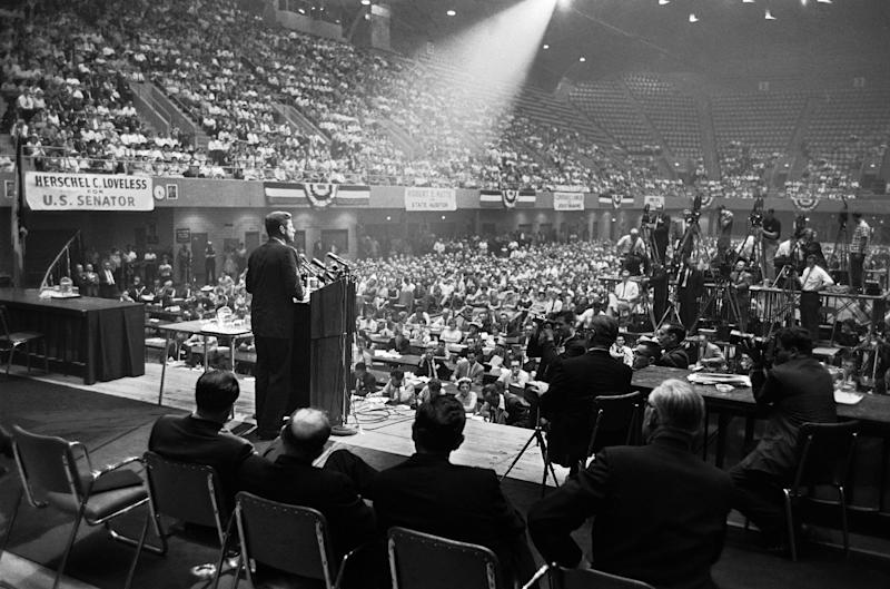 FILE - In this Aug. 21, 1960 file photo, illuminated by a spotlight, Sen. John F. Kennedy, Democratic presidential nominee, speaks to an audience in Des Moines, Iowa. (AP Photo)
