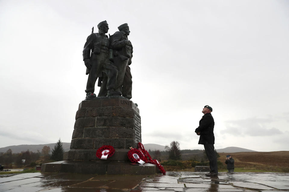 A small number of serving and former Royal Marine Commandos gather, at the Commando Memorial for the annual Remembrance Sunday ceremony, at Spean Bridge, near Fort William, Scotland, Sunday, Nov. 8, 2020. (Andrew Milligan/PA via AP)
