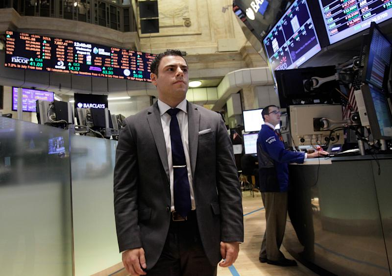 In this Wednesday, Aug. 1, 2012 photo, New York Stock Exchange Senior Compliance Associate Matthew Pizzo, an Air Force veteran who has law and business degrees, walks the trading floor of the New York Stock Exchange. Pizzo had gone two years without work, until recently, as he is now finishing his first week of work at the exchange. U.S. employers added 163,000 jobs in July, a hopeful sign after three months of sluggish hiring. (AP Photo/Richard Drew)