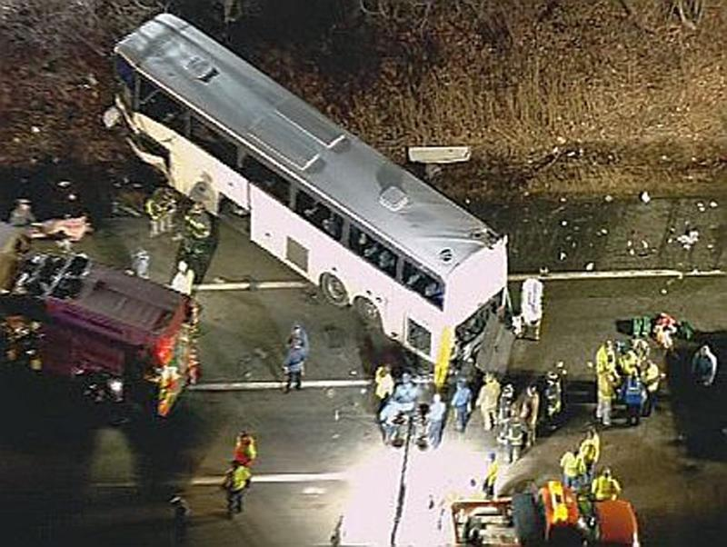 AN image made from video provided by CBS-2 News WCBS-TV New York shows a luxury bus that crashed on the New Jersey Turnpike late Monday, March 14, 2011.  Police said the crash killed the driver and another person. (AP Photo/CBS-2) MANDATORY CREDIT