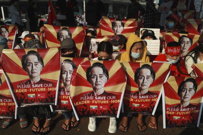 FILE - In this Feb. 20, 2021, file photo, anti-coup protesters hold identical posters with an image of deposed Myanmar leader Aung San Suu Kyi as they gather outside the Hledan Centre in Yangon, Myanmar. One hundred days since their takeover, Myanmar's ruling generals maintain just the pretense of control over the country. There are fears the military takeover is turning Myanmar into a failed state. (AP Photo, File)