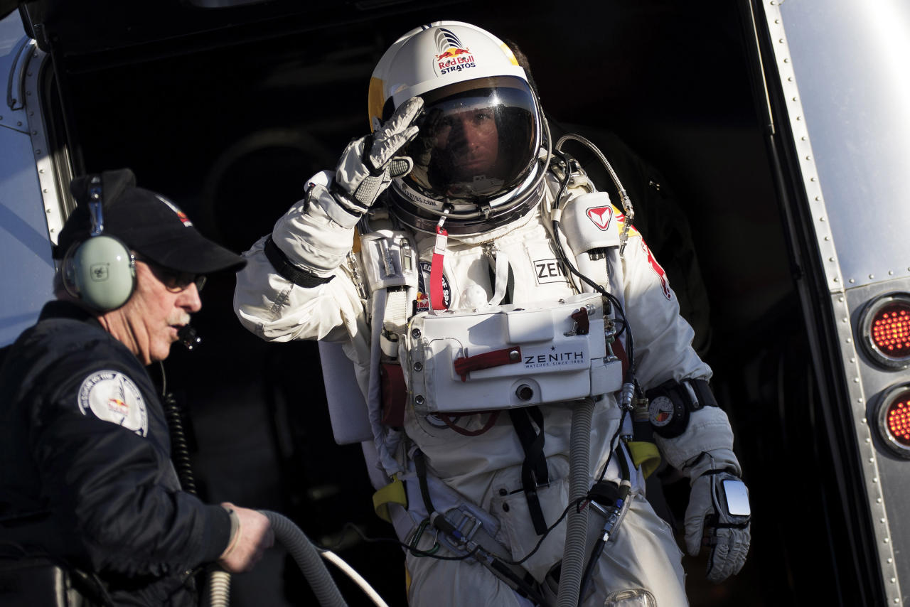 In this photo provided by Red Bull Stratos, Felix Baumgartner salutes as he prepares to board the capsule carried by a balloon during the first manned test flight for Red Bull Stratos in Roswell, N.M. on Thursday, March 15, 2012. Baumgartner is more than halfway toward his goal of setting a world record for the highest jump. A spokesperson says the skydiver took a practice jump from more than 13 miles high over New Mexico. He's aiming for nearly 23 miles in the summer. The record is held by Joe Kittinger who jumped from 19.5 miles in 1960. (AP Photo/Red Bull Stratos, Joerg Mitter)