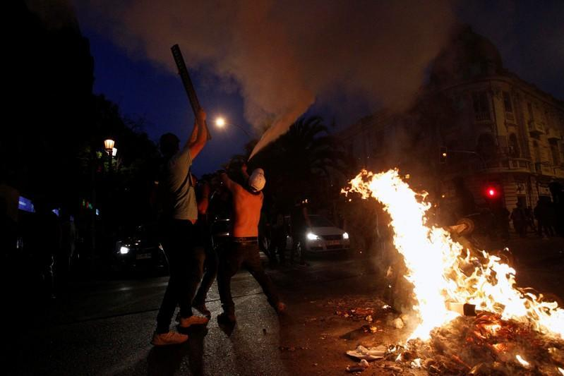 Demonstrators take part in a protest against the increase in the subway ticket prices in Santiago