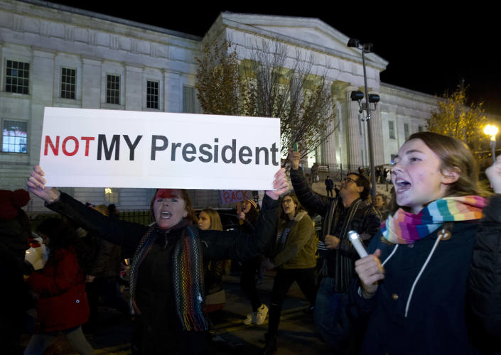 """<p>A demonstrator holds a banner as they protest during a march in downtown Washington in opposition of President-elect Donald Trump, on Saturday, Nov. 12, 2016. More than 200 people, carrying signs, gathered on the steps of the Washington state Capitol. The group chanted """"not my president"""" and """"no Trump, no KKK, no fascist USA."""" ( AP Photo/Jose Luis Magana) </p>"""