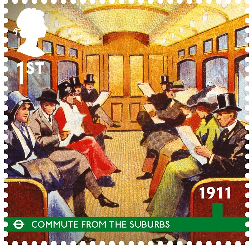 A carriage of Edwardian men and women enjoy a quiet commute from the suburbs, 1911 (Royal Mail)