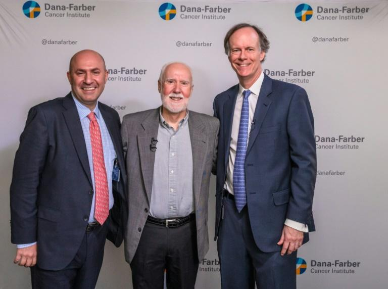 Cancer patient Shaun Tierney (C) is seen here with his doctor Toni Choueiri (L) and Nobel prize winner William Kaelin (R) at the Dana-Farber Cancer Institute in Boston