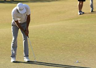 Dustin Johnson three putts the 18th hole to lose the U.S. Open. (AP)