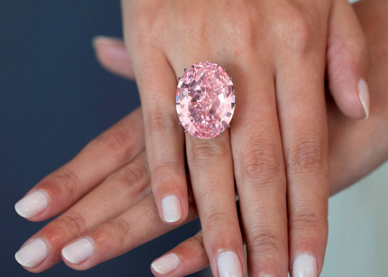 "<p>A diamond described as ""one of the world's great natural treasures"" has been sold for a record-breaking £57.1 million. The Pink Star is a 59.6-carat oval mixed-cut gem which is the largest Internally Flawless Fancy Vivid Pink diamond ever graded by the Gemological Institute of America. It is more than twice the size of the 24.78-carat 'Graff Pink' – which previously held the world auction record for any pink diamond. Sotheby's auctioned The Pink Star in Hong Kong. (Sotheby's/SWNS.com) </p>"