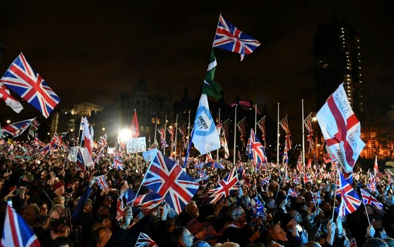 Thousands of people waving Union Jack flags packed Parliament Square in London Saturday to herald Brexit